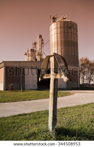 Cross in the front of silo - stock photo