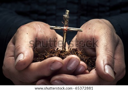 Cross in the hands - stock photo
