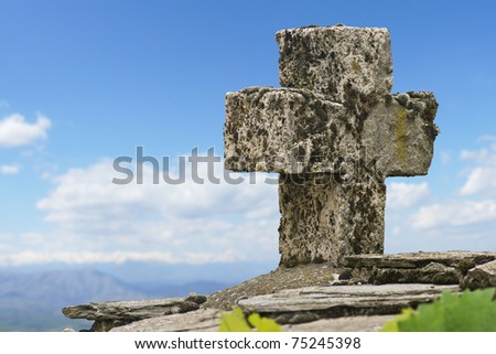 Cross made of stone - stock photo