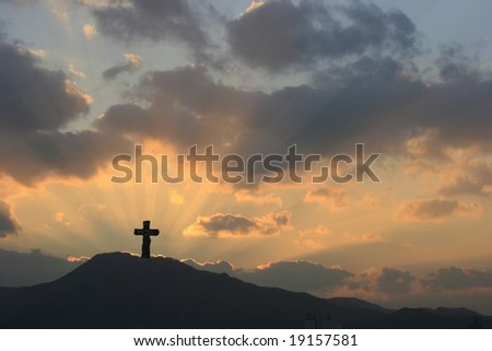 Cross on Dramatic Sunset - stock photo