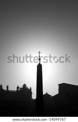 Cross on stella in Vatican silhouette version - stock photo