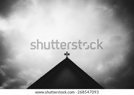 cross on the church roof - stock photo