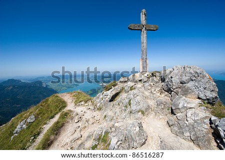 Cross on the top of the 1784 meters high mountain Schafberg in Austria - stock photo