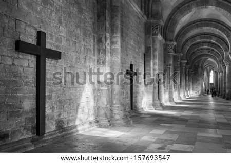 Cross on the wall of an arcade, basilique sainte marie madeleine, vezelay (a place of pilgrimage), Burgundy, France - stock photo