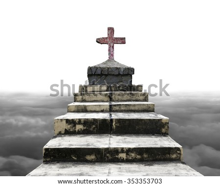 Cross on top of old concrete stairs, with gray cloudscape background. - stock photo