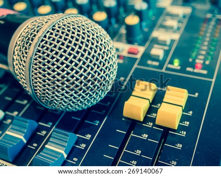 Cross process color photo of a microphone on amplifier equipment. - stock photo