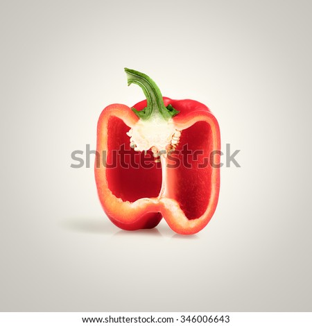 Cross-section of a Red Pepper on white gradient background - stock photo
