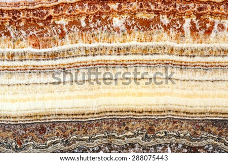 Cross Section of Stratum Sedimentary Layers - stock photo