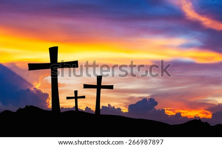cross silhouette on mountain with twilight sky. - stock photo