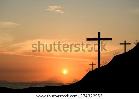 Cross silhouette. Sunset background. - stock photo