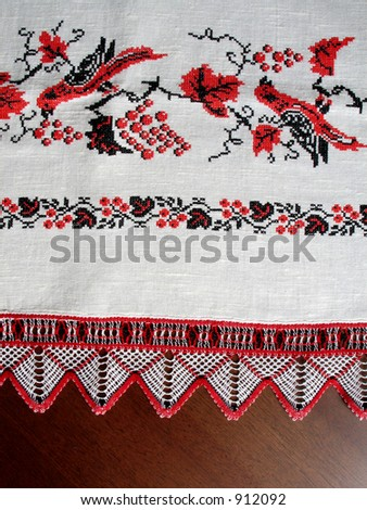 Cross-stitch. Traditional black and red ukrainian design, birds and berries. (I'm creator) - stock photo