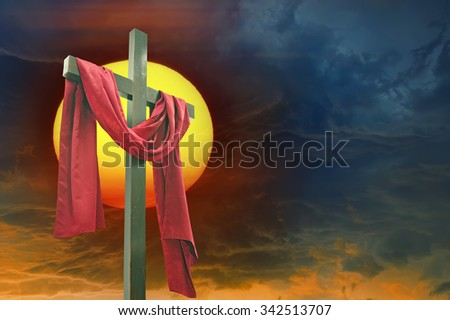 Cross, sun and  dramatic sky - stock photo