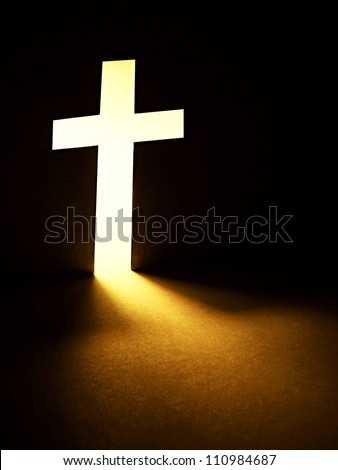 Cross with light shafts. Faith symbol. - stock photo