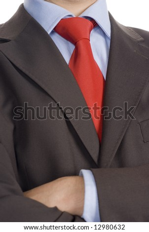 crossed arms and well dressed business man - stock photo