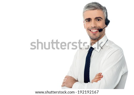 Crossed arms call center operator with headset - stock photo