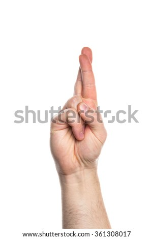 Crossed fingers hand sign - stock photo