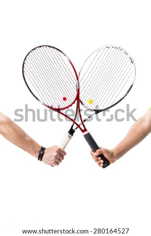 Crossed tennis rackets isolated - stock photo