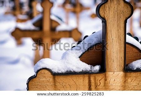 crosses at a cemetery in winter - stock photo