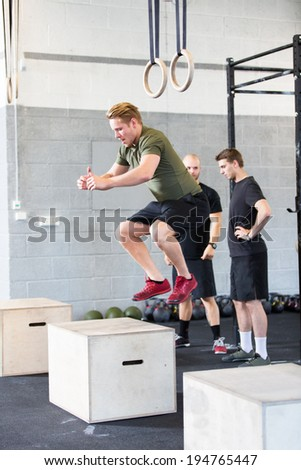 Crossfit box jump traning - stock photo