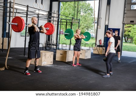 Crossfit training with weights and kettlebells - stock photo