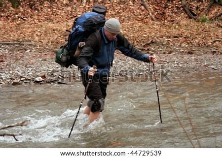 Crossing a river to ford. - stock photo