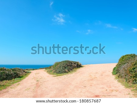 crossroads in a red country road by Porticciolo shore, Sardinia - stock photo