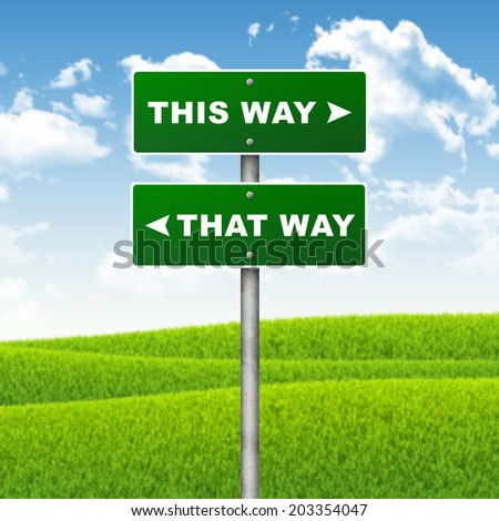 Crossroads road sign. Pointer to the right THIS WAY, but THAT WAY left. Choice concept - stock photo