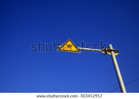crossroads traffic signs in blue sky, closeup of photo - stock photo