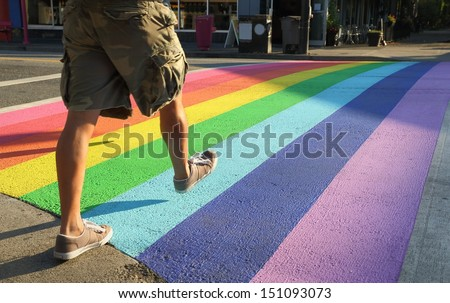Crosswalk Colors, Gay Pride, Vancouver. Vancouver�s first permanently rainbow colored crosswalk at the intersection of Davie and Bute in downtown Vancouver, British Columbia, Canada.  - stock photo