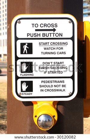 Crosswalk sign on post - stock photo