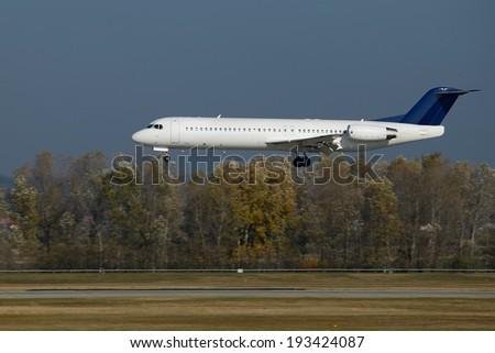 Crosswind landing of a plane - stock photo