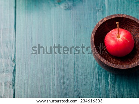Crostini, bruschetta with plum, berry marmalade  and goat cheese on a blue turquoise blue background - stock photo