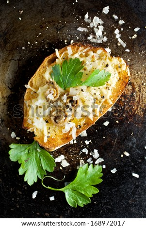 Crostini with cheese, anchovy, onion and parsley - stock photo