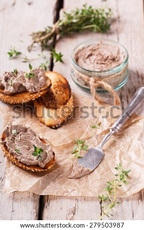 Crostini with liver pate - stock photo