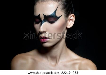 Crow girl. Halloween face art. Halloween - stock photo