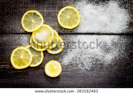 Crowbar fresh lemon and sugar on the table, top view. - stock photo