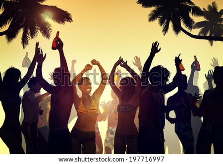 Crowd Dancing by the Beach - stock photo