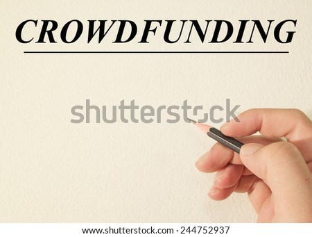 crowd funding text concept write on wall paper  - stock photo
