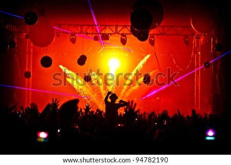 Crowd Man On shoulders Hands In Air - Pyrotechnics Explosion - stock photo