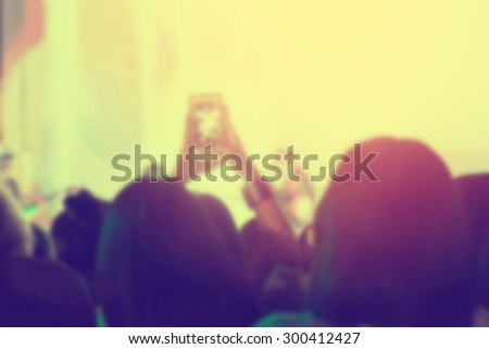 crowd of Audience enjoying music in concert on stage - stock photo