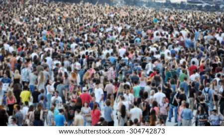 Crowd of blurred people - stock photo