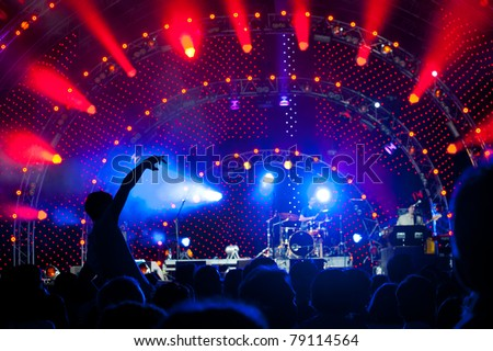 Crowd of fans at an open-air live concert - stock photo