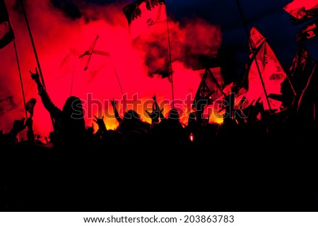 Crowd of fans at open-air rock festival - stock photo