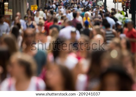 Crowd of people walking on street sidewalk in New York City - stock photo