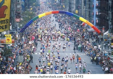 Crowd of runners crossing 1st Avenue/ 59th Street bridge, NY, NY City Marathon - stock photo