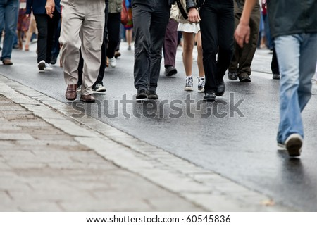 Crowd walking - group of people walking together (motion blur) - stock photo