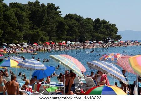 Crowded beach - stock photo