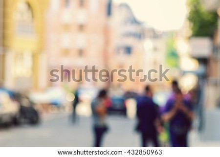 Crowded blurred street in Kyiv. Blurred people background. People walking through a city street.  - stock photo