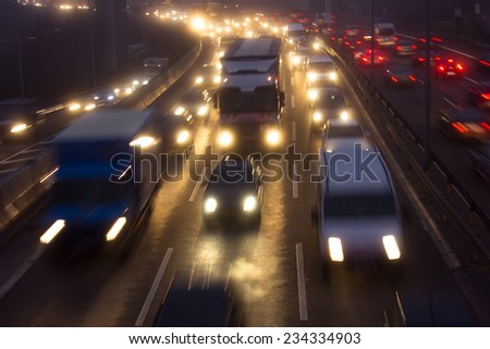 Crowded Freeway in Misty Weather - stock photo