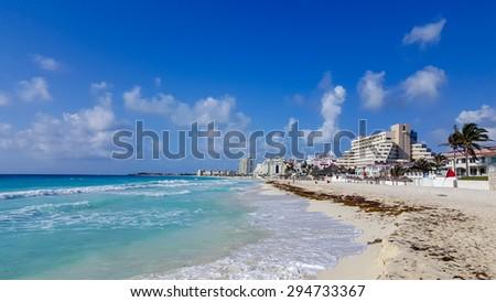 Crowded hotel zone along Caribbean sea coast, always warm and sunny Cancun, Mexico - stock photo